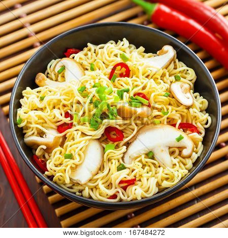 Asian meal made of instant noodles and shiitake mushrooms traditional oriental food top view