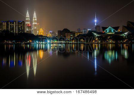 Kuala Lumpur City at Night with water reflection, Malaysia. Kuala Lumpur Cityscape.
