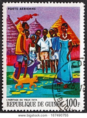 GUINEA - CIRCA 1968: a stamp printed in Guinea shows Old Faya's Inheritance African Legends circa 1968
