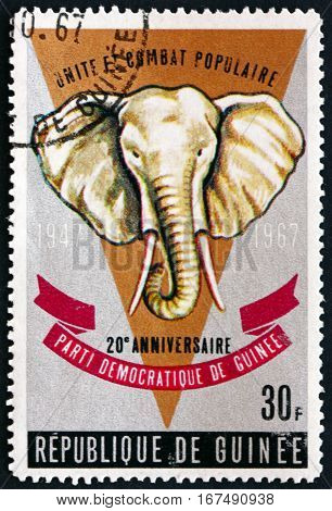 GUINEA - CIRCA 1967: a stamp printed in Guinea shows Elephant 20th Anniversary of the Democratic Party of Guinea circa 1967