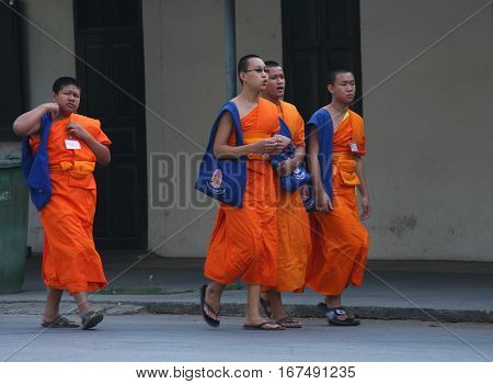 CHIANG MAI, THAILAND. February 25, 2010: Daily life in a Buddhist monastery. The monks go to the city to collect alms.