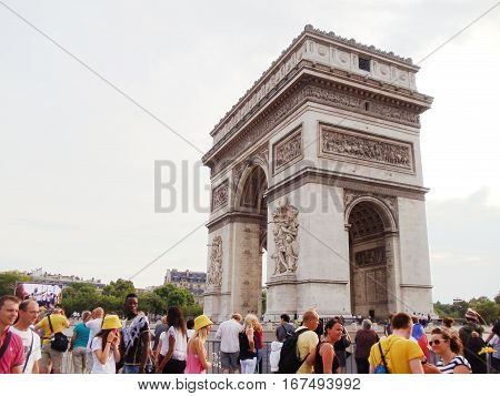 July 27 - Paris, France. People near Arc de Triomphe famous symbol of Paris during summer day. Clear sky background with empty copyspace