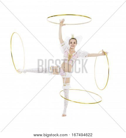 A gymnast standing twirling a hula hoop on white background. Studio photography of circus performers.