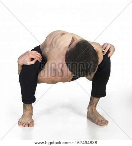 Extraordinary gymnast on a white background. The man with no bones. Studio photography of circus performers..