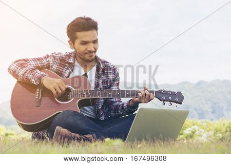 Handsome Man Smiling, Playing Guitar