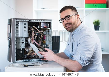 Professional Man Repairing And Assembling A Computer Desktop