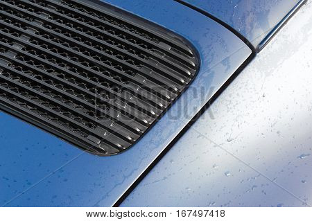 raindrops on a vehicle panel and grille