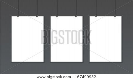 Empty white vector poster templates on dark gray background. Poster mock up. Template of three white blank vector posters. Collection of paper poster mockups hanging on wall. Frame for paper sheet.