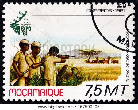 MOZAMBIQUE - CIRCA 1981: a stamp printed in Mozambique shows Hunters Shooting World Hunting Exhibition Plovdiv Bulgaria circa 1981