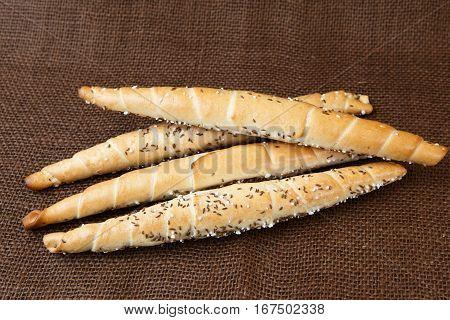 Chopsticks - Bread sticks on brown background