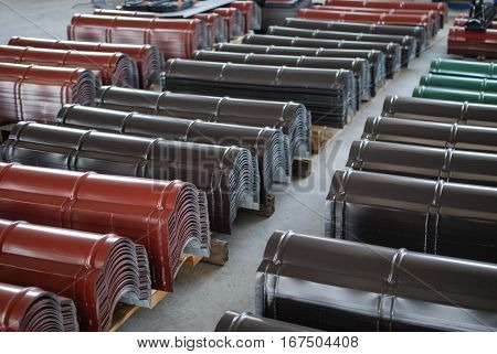 Metal roof flashing in various colors stacked in the warehouse