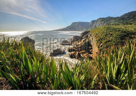 Punakaiki, New Zealand, Collapsed cliff on a shoreline in Punakaiki near Pancake rocks area.