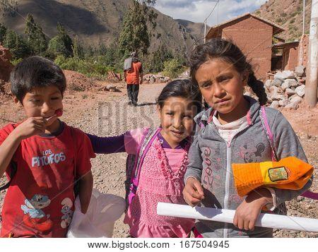 Urubamba Peru - May 20 2016: Peruvian children waiting for sweets