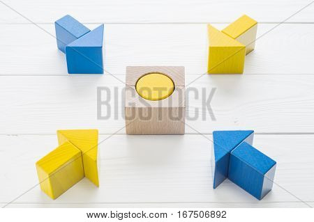 Symbol of goal and objective. Four wooden arrows converge towards the center target. Arrows pointing to the object. Business concept. The concept of the goal the implementation of the planned success
