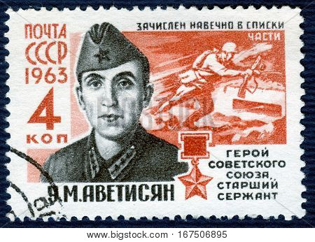 USSR - CIRCA 1963: Postage stamp  printed in USSR shows portrait of U. M. Avetisyan, the senior sergeant, Hero of the Soviet Union, from the series