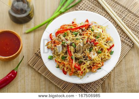 Asian meal made of rice noodles tofu vegetables and shiitake mushrooms. Traditional Oriental cuisine meal. Top view.