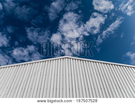 Industrial building with corrugated sheet metal facade
