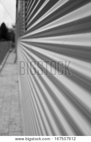 Corrugated metal facade background in black and white