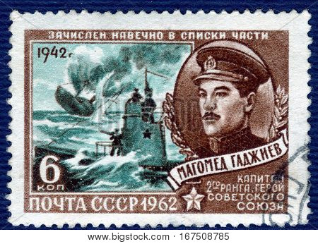 USSR - CIRCA 1962: Postage stamp  printed in USSR shows portrait of Magomed Hajiyev (1942), Captain of the 2nd rank, Hero of the Soviet Union, from the series