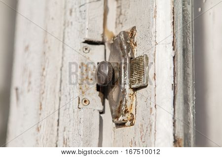 Closeup and vintage door locked with latch