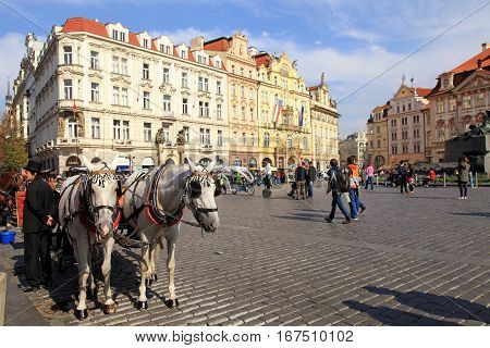 PRAGUE CZECH REPUBLIC - OCTOBER 4 2015: Old Town square with horse drawn carriage and tourists in Prague, Czech Republic.