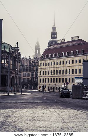 Dresden, Germany - 2 Jan. 2008: Tram lines and empty streets next to the Zwinger on a cold and snowy morning