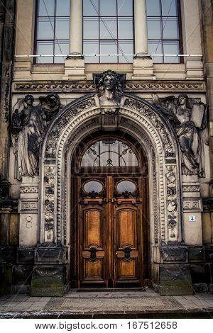 Large European style wooden door at the entrance to an old building
