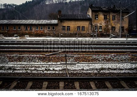 Empty train station in the Czech Republic with a fresh layer of snow on the ground