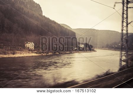 View of the Elbe River in the Czech Republic seen from a passing train at high speed