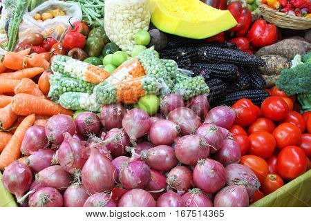 Bin of colorful fresh vegetables at outdoor market in Peru
