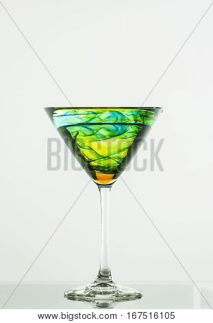 Infused cocktail in a martini glass on white background