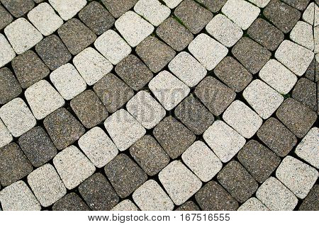 Tile Paving. Small, square tiles laid in the form of a circle