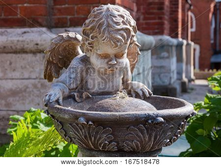 Beautiful sculpture of angel and fountain in the garden.