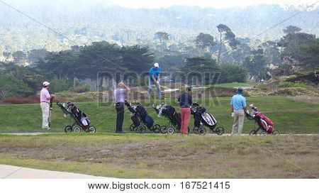 CARMEL, CALIFORNIA, UNITED STATES - OCT 6, 2014: companionship playing at the Pebble Beach Golf Course, which is part of the famous 17 miles drive area.