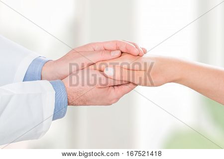 doctor patient care holding human hand trust touch medical thanks help clinic health concept - stock image