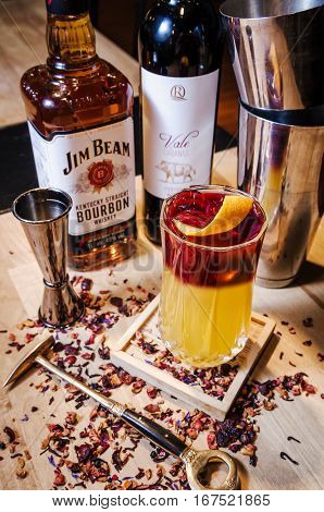 SAINT-PETERSBURG RUSSIA - January 2017: Alcohol orange coctail drink with Jim Beam red vine on restaurant background. Editorial use only.