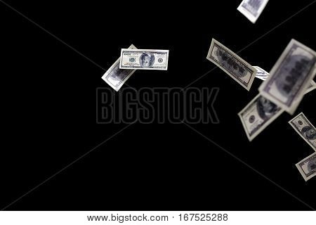 one hundred dollars banknotes isolated fly on black background. money rain concept