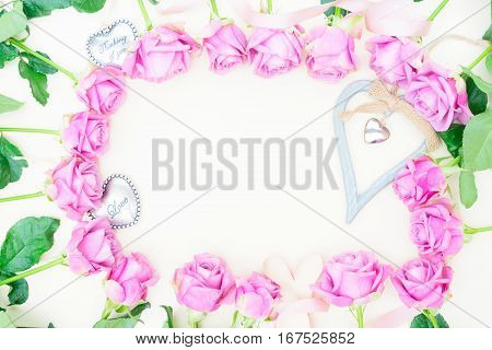 Valentines day violet roses and love hearts top view flat lay frame with copy space