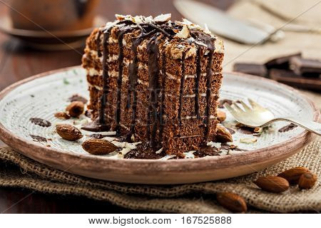 Delicious sweet chocolate Spartak cake on a rustic plate. Haute cuisine dessert. International food. Close-up shot.