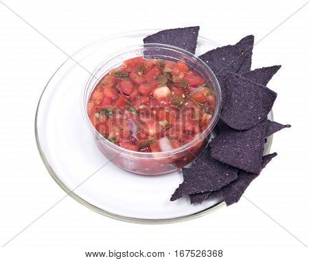 Pico de gallo, authentic mexican salsa in bpa free plastic container and lightly salted organic blue corn tortilla chips isolated on white background