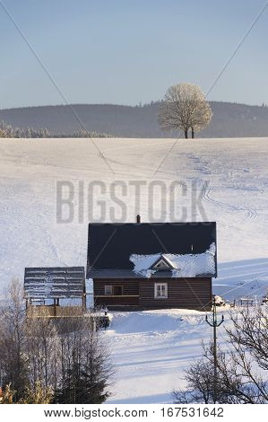 Timbered Cottage In Frosty Mountains Country In Sunny Winter Day
