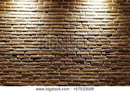 illuminated red brick wall with two spot light