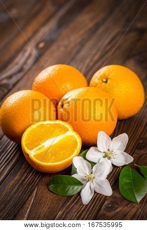 Oranges, Leaves And Flowers On The Table