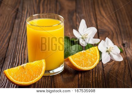 Glass Of Fresh Juice And Sliced Orange
