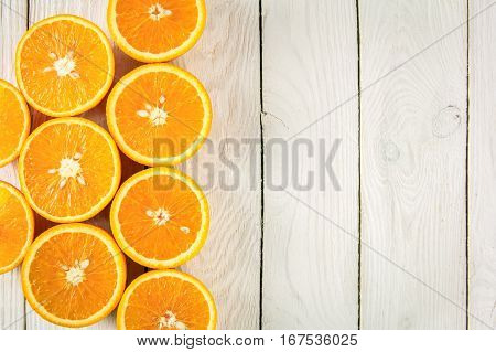 Fresh oranges on a white wooden table