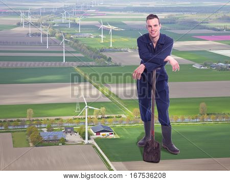 Young giant farmer in aerial view of dutch farmer landscape