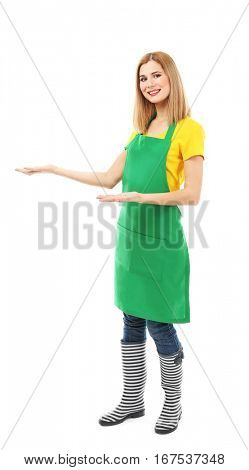 Beautiful woman in green apron isolated on white background