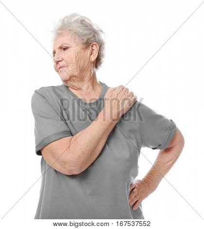Elderly woman suffering from pain in shoulder on white background