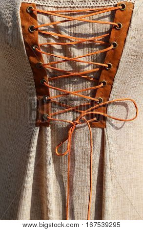 Intertwining With The String Of An Ancient Medieval Dress In Cot