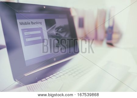 Internet on line mobile banking concept, laptop computer with log in bank account page open